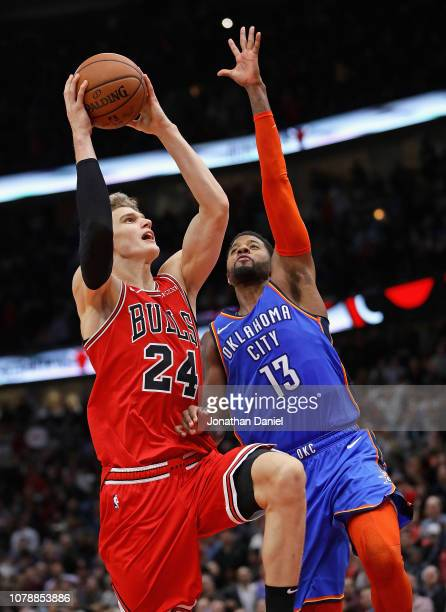 Lauri Markkanen of the Chicago Bulls puts up the gamewinning shot against Paul George of the Oklahoma City Thunder at the United Center on December...