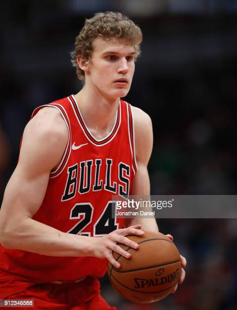 Lauri Markkanen of the Chicago Bulls readies to shoot a free throw against the Milwaukee Bucks at the United Center on January 28 2018 in Chicago...