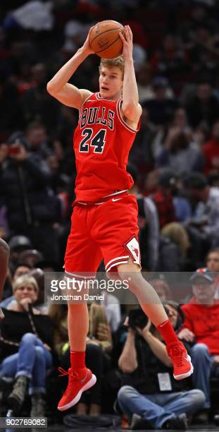 Lauri Markkanen of the Chicago Bulls rebounds against the Houston Rockets at the United Center on January 8 2018 in Chicago Illinois The Rockets...