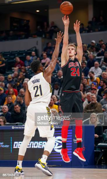 Lauri Markkanen of the Chicago Bulls shoots a jumper against Thaddeus Young of the Indiana Pacers at Bankers Life Fieldhouse on December 6 2017 in...