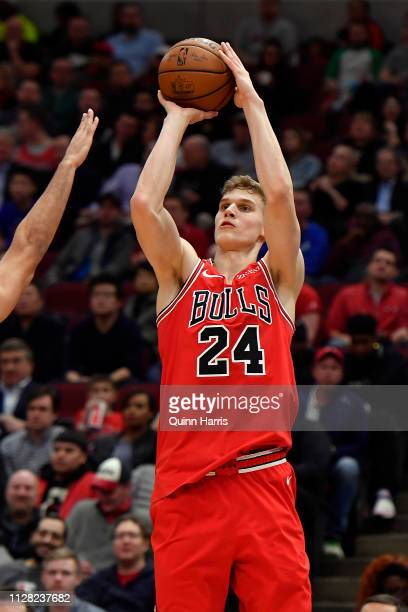 Lauri Markkanen of the Chicago Bulls shoots a three point basket against the New Orleans Pelicans at United Center on February 06 2019 in Chicago...