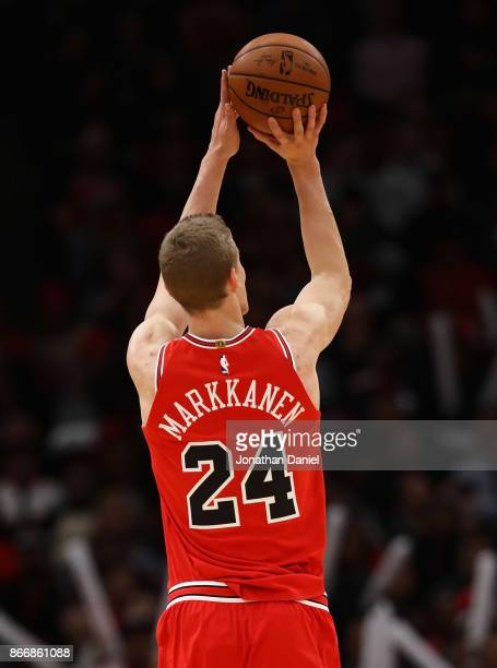 Lauri Markkanen of the Chicago Bulls shoots a three point shot against the Atlanta Hawks at the United Center on October 26 2017 in Chicago Illinois...