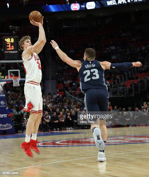 Lauri Markkanen of the Chicago Bulls shoots over Blake Griffin of the Detroit Pistons during the first half of the game at Little Caesars Arena on...