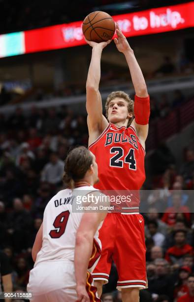 Lauri Markkanen of the Chicago Bulls shoots over Kelly Olynyk of the Miami Heat at the United Center on January 15 2018 in Chicago Illinois The Bulls...