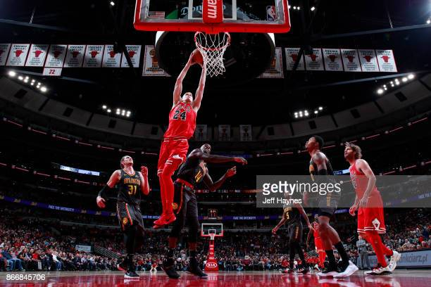 Lauri Markkanen of the Chicago Bulls shoots the ball against the Atlanta Hawks on October 26 2017 at the United Center in Chicago Illinois NOTE TO...