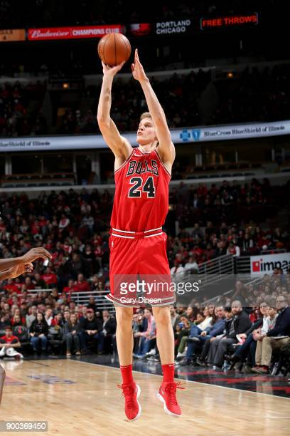Lauri Markkanen of the Chicago Bulls shoots the ball against the Portland Trail Blazers on January 1 2018 at the United Center in Chicago Illinois...