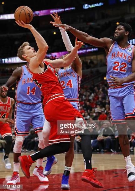 Lauri Markkanen of the Chicago Bulls tries to get off a shot against Dewayne Dedmon Kent Bazemore and Alex Poythress of the Atlanta Hawks at the...