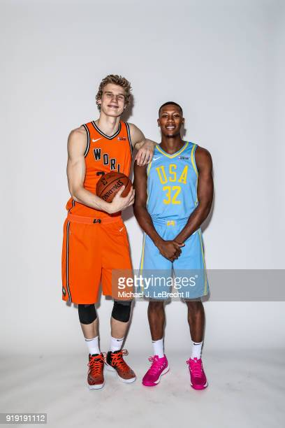 Lauri Markkanen of the World team and Kris Dunn of the USA team pose for a portrait prior to the Mountain Dew Kickstart Rising Stars Game during...
