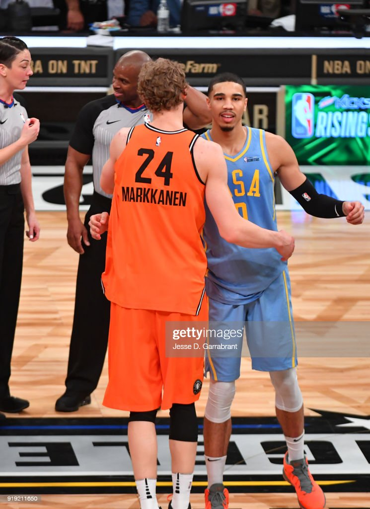 Lauri Markkanen #24 of the World Team congradualtes Jayson Tatum #0 against the USA Team during the Mountain Dew Kickstart Rising Stars Game during All-Star Friday Night as part of 2018 NBA All-Star Weekend at the STAPLES Center on February 16, 2018 in Los Angeles, California.