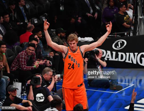 Lauri Markkanen of the World Team raises his hands after hitting a three pointer against the USA Team during the Mountain Dew Kickstart Rising Stars...