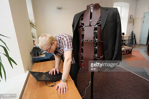 Lauri Mihkels from the technical support team of the Estonian company Fitsme adjusts a shapeshifting robotic mannequin on March 27 2012 at offices in...