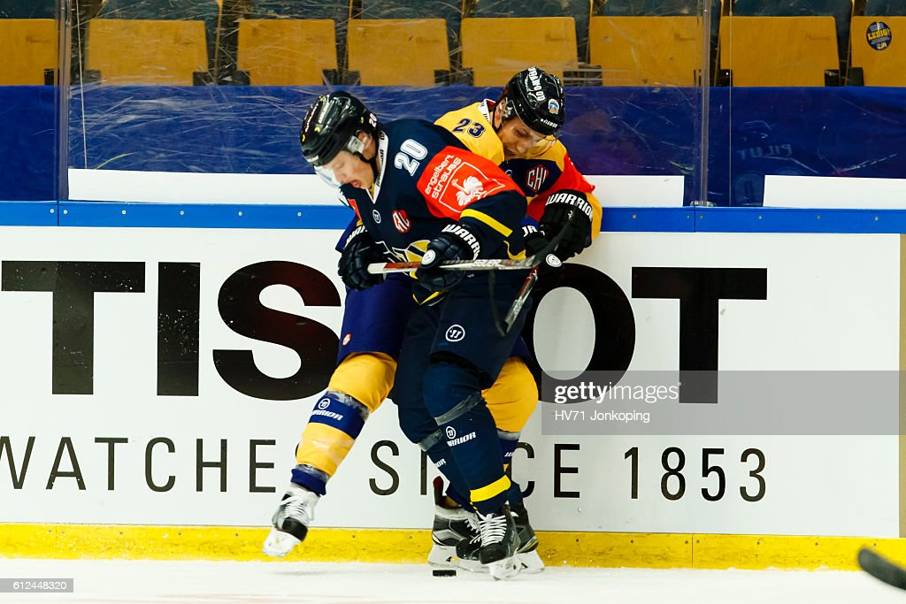 Lauri Tukonen #23 of Lukko Rauma battling for the puck with Lawrence Pilut #20 of HV71 Jonkoping, during the Champions Hockey League Round of 32 match between HV71 Jonkoping and Lukko Rauma at Kinnarps Arena on October 4, 2016 in Jonkoping, Sweden.