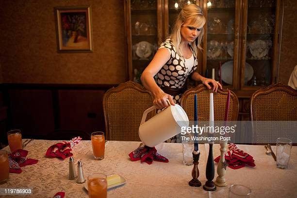 Laurice Romney pours juice before lunch in Colonia Juarez Mexico in July 2011 United States Presidential candidate Mitt Romney's family migrated to...