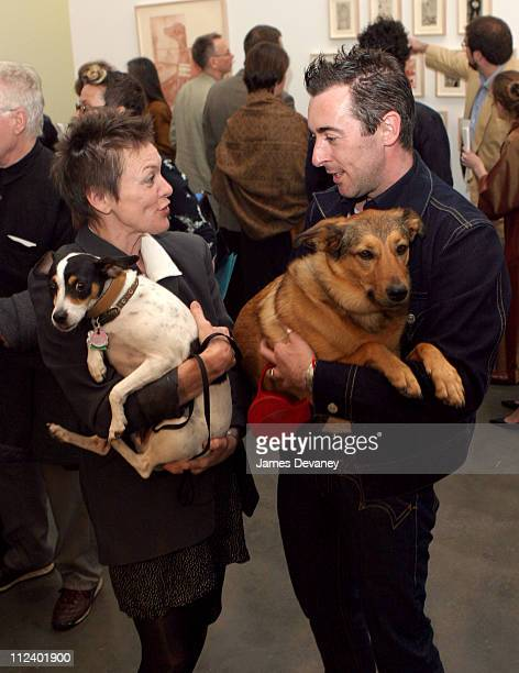 Laurie Anderson with her rat terrier Lolabelle and Alan Cumming with his dog Honey
