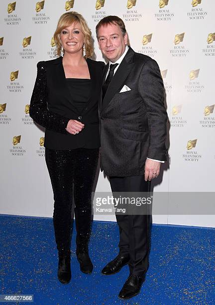 Laurie Brett and Adam Woodyatt attend the RTS Programme Awards at The Grosvenor House Hotel on March 17 2015 in London England