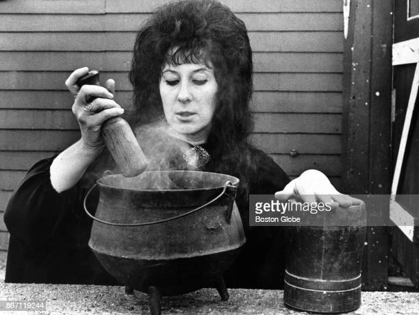 Laurie Cabot, who is considered the official witch of Salem, peers into her cauldron in Salem, MA on Oct. 29, 1974.