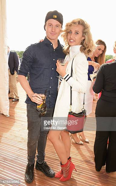Laurie Calvert and Jamey May attend day one of the Audi Polo Challenge at Coworth Park on May 30 2015 in London England