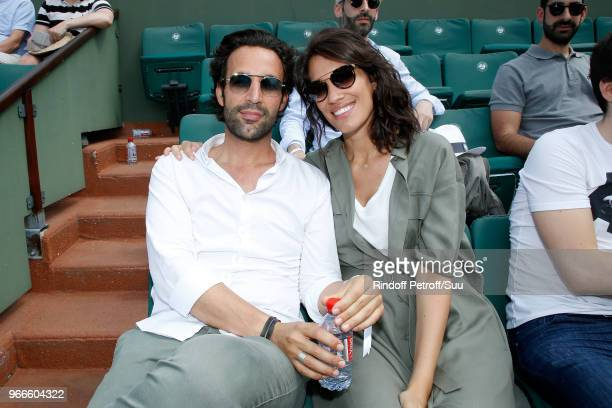 Laurie Cholewa and her companion Greg Levy attend the 2018 French Open Day Eight at Roland Garros on June 3 2018 in Paris France