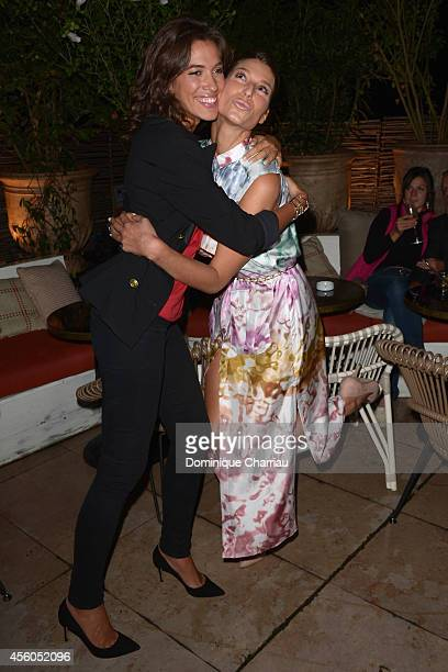 Laurie Cholewa and Laury Thilleman attend the show 'The Art Of Illusion' at Palais De Tokyo on September 24 2014 in Paris France