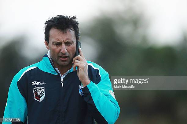 Laurie Daley talks on the phone during a Born To Be Blue Clinic at Coogee Oval on June 17 2013 in Sydney Australia