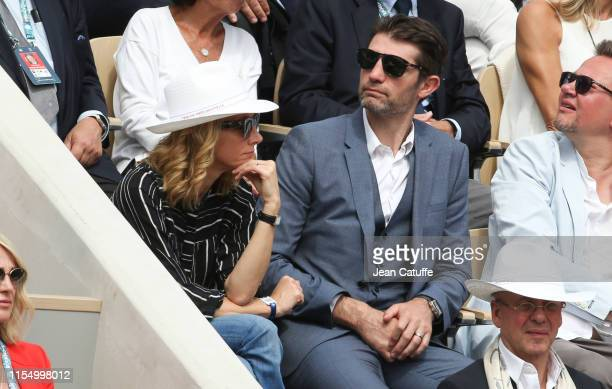 Laurie Delhostal and husband Pierre Rabadan attend the men's final during day 15 of the 2019 French Open at Roland Garros stadium on June 9 2019 in...