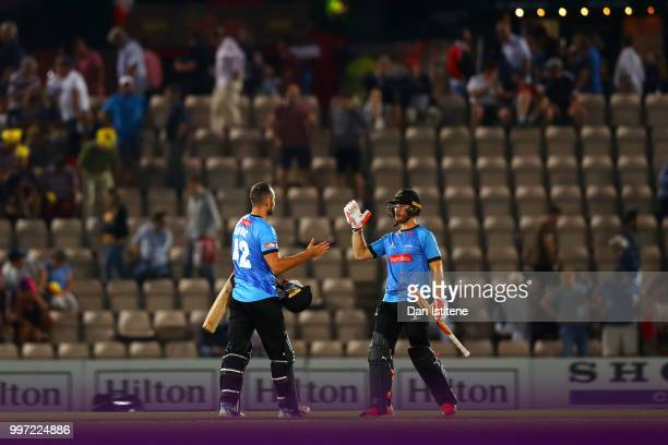 Laurie Evans and Tom Bruce of Sussex Sharks celebrate victory at the end of the Vitality Blast match between Hampshire and Sussex Sharks at The Ageas...