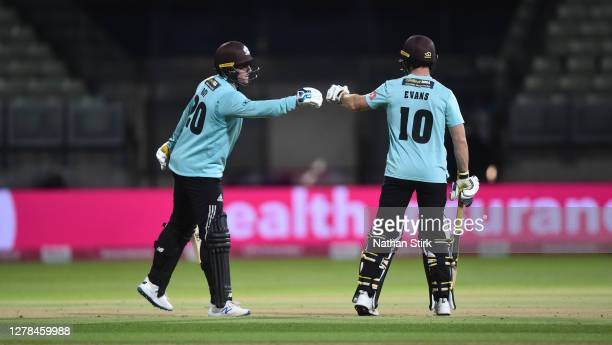 Laurie Evans of Surrey congratulates team mate Jason Roy after he scores 50 runs during the Vitality Blast 2020 final match between Surrey and Notts...