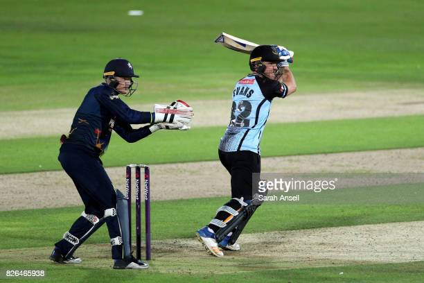 Laurie Evans of Sussex Sharks hits out as Kent Spitfires wicket keeper Sam Billings looks on during the match between Kent Spitfires and Sussex...