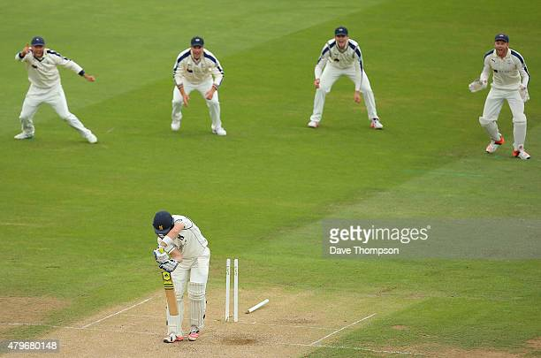Laurie Evans of Warwickshire is bowled out by Ryan Sidebottom of Yorkshire during day two of the LV County Championship Division One match between...