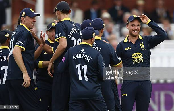 Laurie Evans of Warwickshire is congratulated after catching out Jason Roy of Surrey off the bowling of Chris Wright during the Royal London oneday...