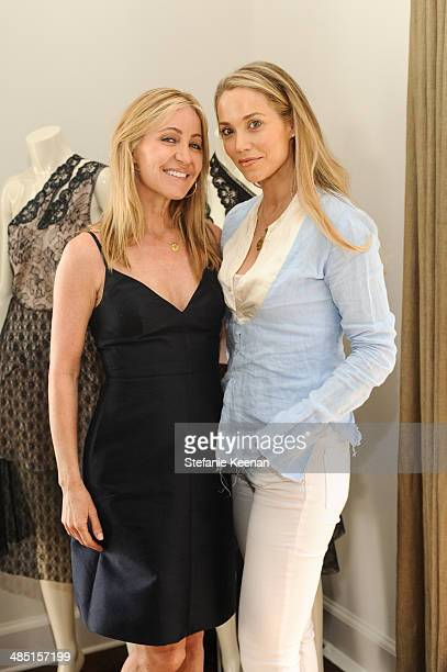 Laurie Feltheimer and Elizabeth Berkley attend Heart Annual Brunch With Stella McCartney on April 16 2014 in West Hollywood California