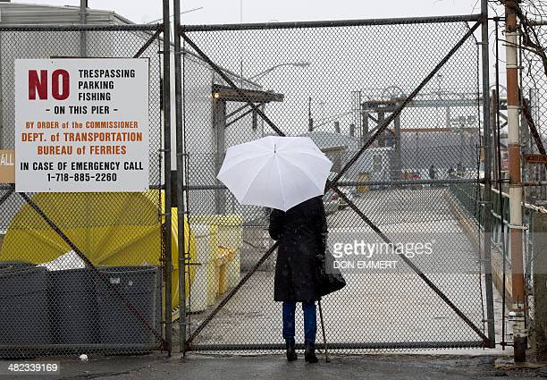 Laurie Grant waits for her New York City Department of Correction escort to be taken to Hart Island March 28 2014 in New York Grant has waited years...