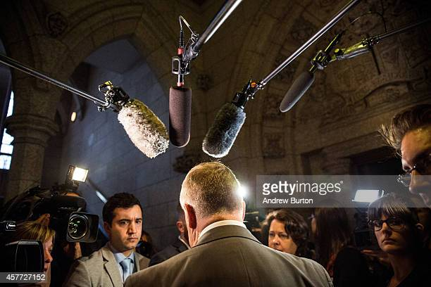 Laurie Hawn a member of the Canadian parliament speaks to the media outside the House of Commons in the Canadian Parliament one day after a gunman...