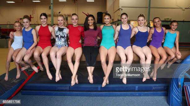 Laurie Hernandez and gymnasts attend an Amazon Original Special An American Girl Story Ivy Julie 1976 A Happy Balance Photo Call with Nina Lu Hannah...