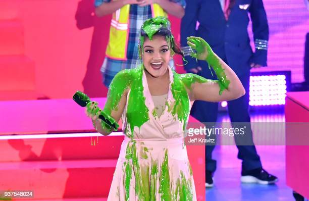 Laurie Hernandez reacts after getting 'slimed' onstage at Nickelodeon's 2018 Kids' Choice Awards at The Forum on March 24 2018 in Inglewood California