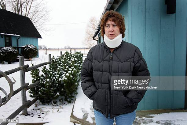 Laurie Johnson the fiancee of handyman Kelly Frank stands outside Frank's home in Simms Mont Frank an excon with a violent past spent three years...