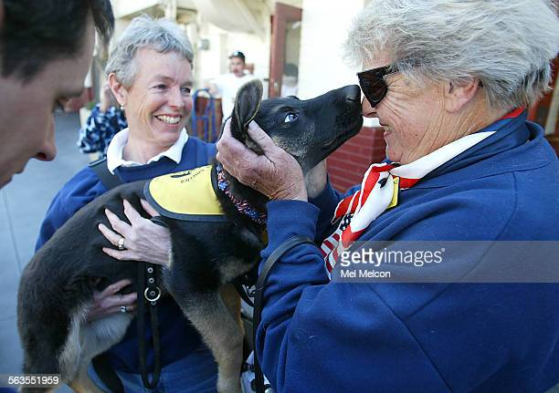 Laurie King of Van Nuys right greets Liebling a 3 and 1/2 month old guide dog held by her trainer Ann Benya of LA King is also a guide dog trainer...