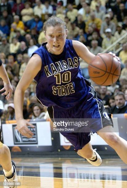 Laurie Koehn 10 drives past Emily Heikes 52 for one of her 22 points in Purdue's win over Kansas State 7969 in the State Farm TipOff Classic