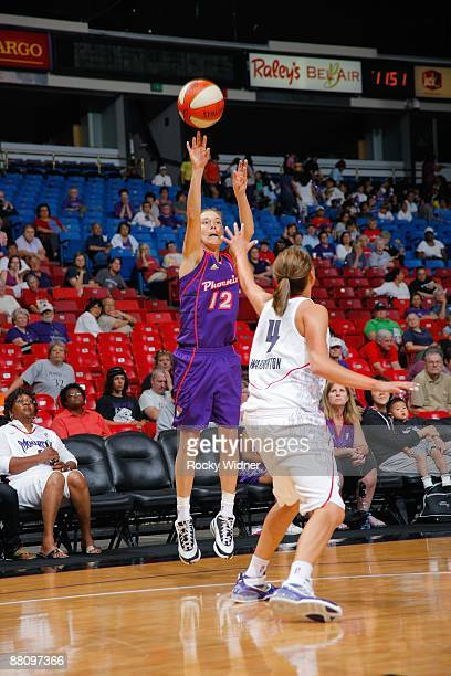 Laurie Koehn of the Phoenix Mercury shoots the ball over Morgan Warburton of the Sacramento Monarchs during the WNBA preseason game on May 27 2009 at...