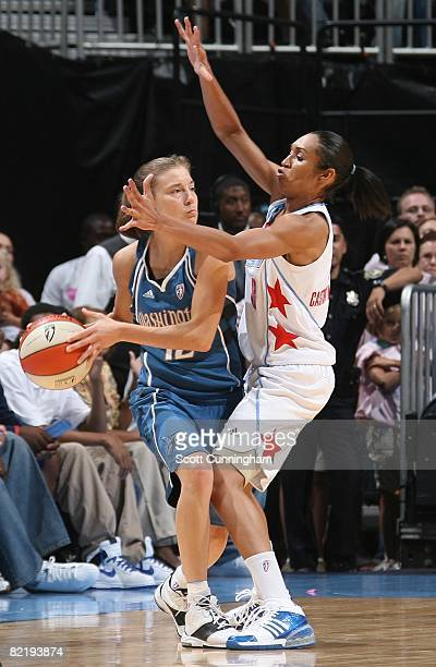 Laurie Koehn of the Washington Mystics looks to pass the ball under pressure against Iziane Castro Marques of the Atlanta Dream during the WNBA game...