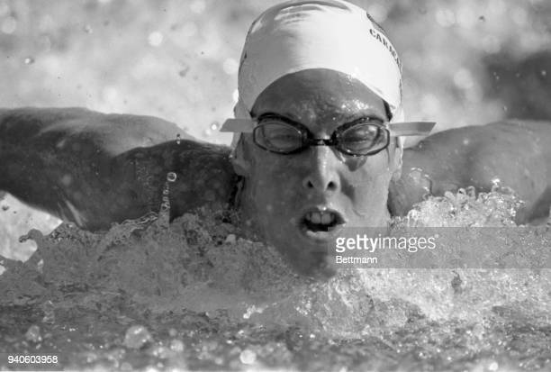 Laurie Lehner of Ratcliff KY swims her way to a gold medal in the women's 100meter butterfly of the Pan American Games swimming competition in Caracas