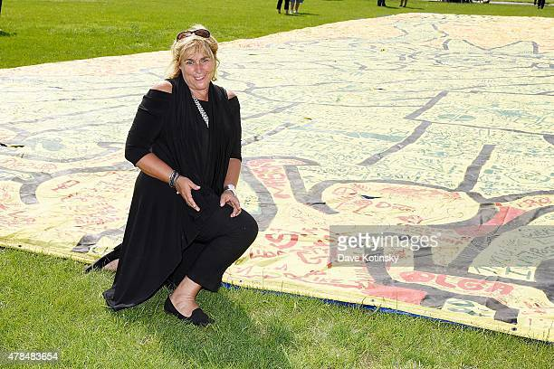Laurie Meadoff poses with Keith Harings Largest Piece of Artwork CityKids Speak on Liberty Banner displayed at Liberty State Park on June 25 2015 in...