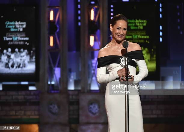Laurie Metcalf accepts the Best Performance by an Actress in a Featured Role in a Play award for Edward Albee's Three Tall Women onstage during the...