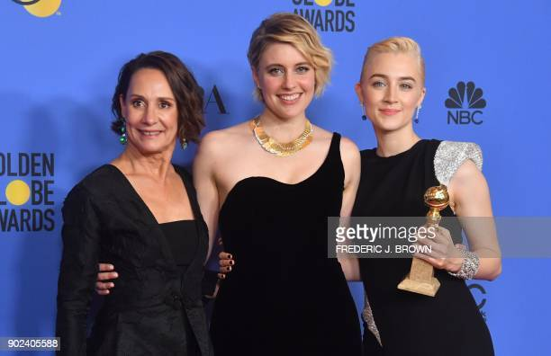 Laurie Metcalf Greta Gerwig and Saoirse Ronan poses with the award for Best Motion Picture Musical or Comedy in 'Lady Bird' during the 75th Golden...