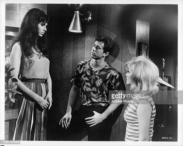 Laurie Mock meets new friends Gene Kirkwood and Mimsy Farmer in a scene from the film 'Hot Rods To Hell' 1966