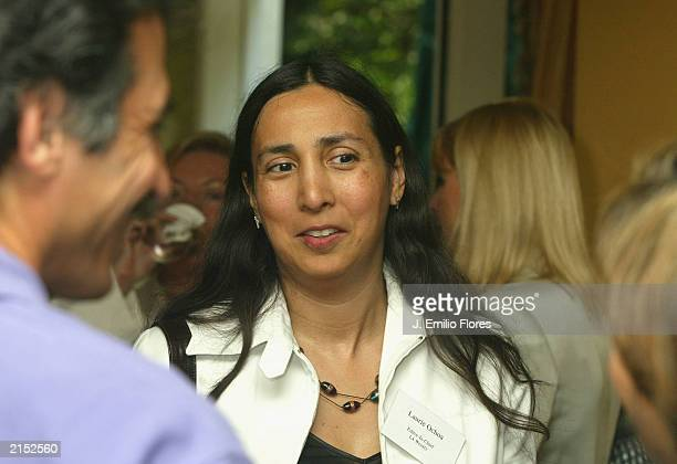 Laurie Ochoa EditorinChief of LA WEEKLY chats with other media members during a 'meetandgreet' between William Bratton The Chief of the Los Angeles...