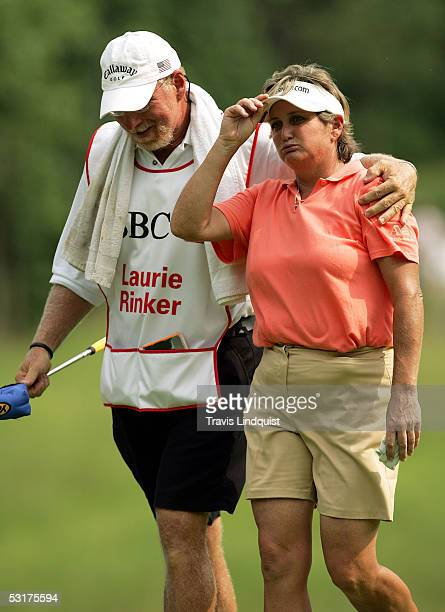 Laurie Rinker walks off the 17th green with her caddie after defeating Lorena Ochoa of Mexico 21 during the first round of the HSBC Women's World...