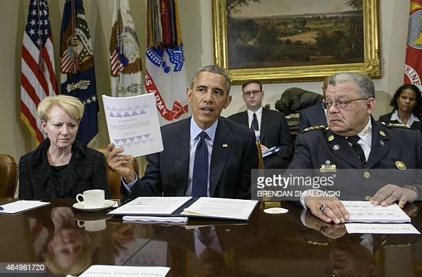 Laurie Robinson professor of Criminology at George Mason University and Philadelphia Police Commissioner Charles H Ramsey listen while US President...