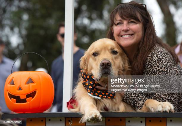 Laurie Zerbonia and 3yearold Henry get their Halloween photo taken at Goldie Palooza 2018 in Huntington Beach on Sunday October 14 2018