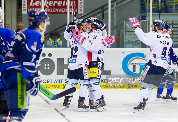 Laurin Braun Sven Ziegler and Henry Haase of the Eisbaeren Berlin celebrate after scoring the 13 during the game between the Straubing Tigers and the...